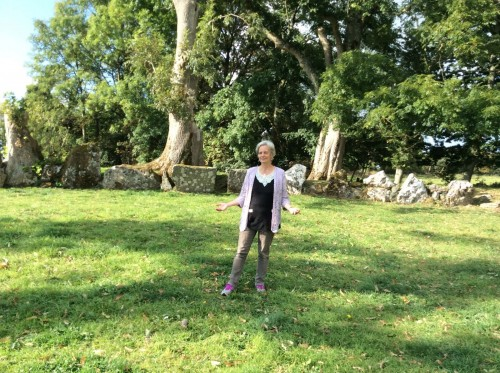 Jackie Queally in Lough Gur Stone Circle on Earthwise Sacred Ireland tour